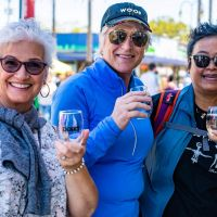 Friends tasting festival wines